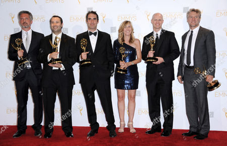 From left, Connor Schell, John Dahl, Bill Simmons, Maura Mandt, Dan Silver, and Tate Donovan pose in the press room with the award for outstanding special class - short-format nonfiction programs for 30 for 30 Shorts at the 2014 Creative Arts Emmys at Nokia Theatre L.A. LIVE, in Los Angeles