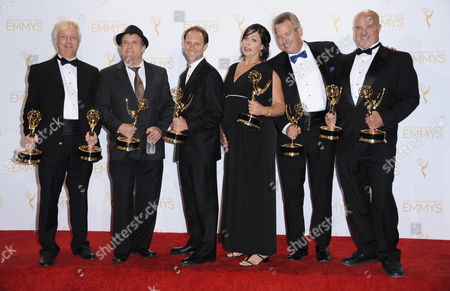 Stock Photo of From left, Christopher Harvengt, Richard S. Steele, Jason Tregoe Newman, Lisa Varetakis, Bill Bell and Bob Costanza pose in the press room with the award for outstanding sound editing for nonfiction programming for Cosmos: A Spacetime Odyssey at the 2014 Creative Arts Emmys at Nokia Theatre L.A. LIVE, in Los Angeles