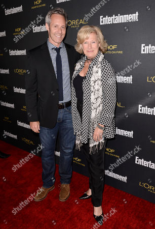 Michael Gill, left, and Jayne Atkinson arrive at Entertainment Weekly's Pre-Emmy Party sponsored by L'Oreal Paris and Hearts On Fire at Fig & Olive in West Hollywood, Calif. on