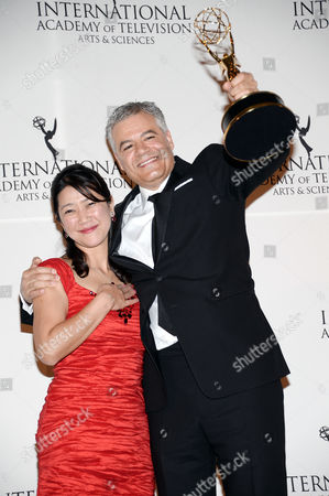 """Stock Image of Arts Programming"""" award winners Miho Yamamoto, left, and Damon Vignale pose in the International Emmy Awards press room at the New York Hilton, in New York"""