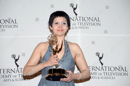 "Documentary"" award winner Maryam Ebrahimi poses in the International Emmy Awards press room at the New York Hilton, in New York"