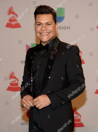 Victor Florencio arrives at the 15th annual Latin Grammy Awards at the MGM Grand Garden Arena, in Las Vegas