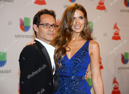 Marc Anthony, left, and his wife Shannon De Lima arrive at the 15th annual Latin Grammy Awards at the MGM Grand Garden Arena, in Las Vegas