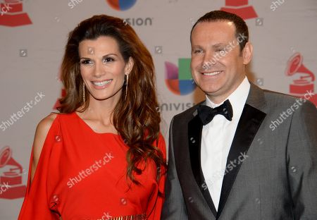 Cristina Bernal, left, and Alan Tacher arrive at the 15th annual Latin Grammy Awards at the MGM Grand Garden Arena, in Las Vegas