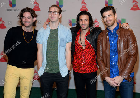 Ben Spivak, from left, Alex Tanas, Nasri and Mark Pellizzer, of the musical group Magic!, arrive at the 15th annual Latin Grammy Awards at the MGM Grand Garden Arena, in Las Vegas
