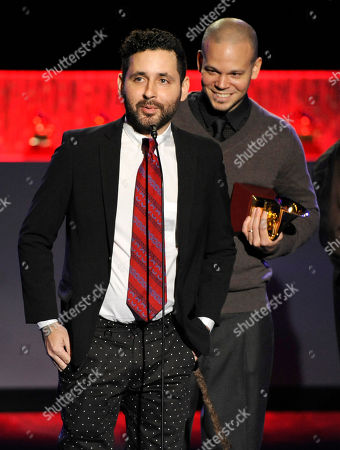 """Visitante, left, and Rene Perez Joglar, of the musical group Calle 13, accept the award for best alternative song for """"El Aguante"""" at the 15th annual Latin Grammy Awards at the MGM Grand Garden Arena, in Las Vegas"""