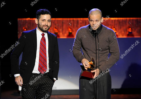 """Eduardo Cabra, also known as """"Visitante,"""" left, and Rene Perez Joglar, of the musical group Calle 13, accept the award for best alternative song for """"El Aguante"""" at the 15th annual Latin Grammy Awards at the MGM Grand Garden Arena, in Las Vegas"""