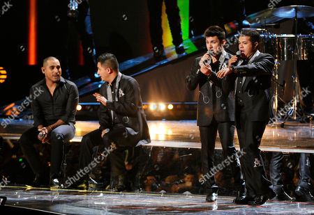Stock Picture of Espinoza Paz, left, and members of La Arrolladora Banda El Limon perform at the 15th annual Latin Grammy Awards at the MGM Grand Garden Arena, in Las Vegas