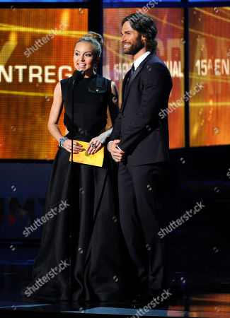 Angelique Boyer, left, and Sebastian Rulli present the award for album of the year at the 15th annual Latin Grammy Awards at the MGM Grand Garden Arena, in Las Vegas