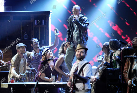 """Rene Perez Joglar, left, and Eduardo """"Visitante"""" Cabra, of the musical group Calle 13, perform on stage at the 15th annual Latin Grammy Awards at the MGM Grand Garden Arena, in Las Vegas"""