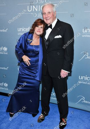 Susan Ekins, left, and Jerry Weintraub arrive at the 2014 UNICEF Ball on in Beverly Hills, Calif