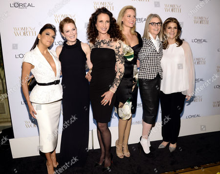 From left, Eva Longoria, Julianne Moore, Andie MacDowell, Aimee Mullins, Diane Keaton and Karen Fondu attend the Ninth Annual Women of Worth Awards hosted by L'Oreal Paris at The Pierre hotel, in New York