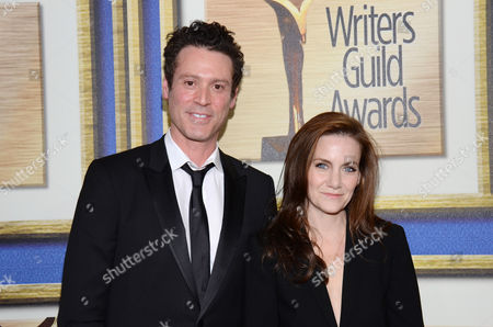 Craig Borten, left, and Melisa Wallack arrive at the Writers Guild Awards,, in Los Angeles