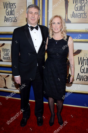 Christopher Keyser, left, and guest arrive at the Writers Guild Awards,, in Los Angeles