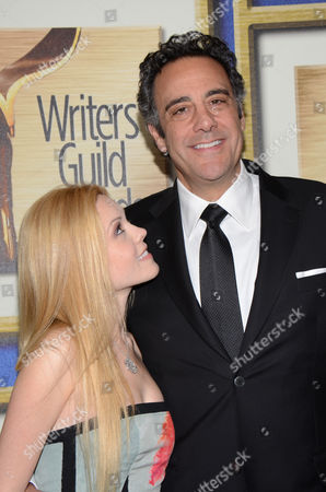 Isaball Quella, left, and Brad Garrett arrive at the Writers Guild Awards,, in Los Angeles