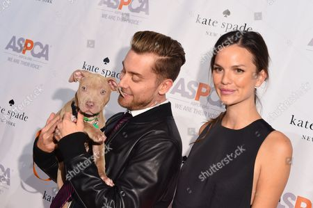 Singer Lance Bass, left, and model Allie Rizzo attend the ASPCA Young Friends Benefit at the IAC Building, in New York