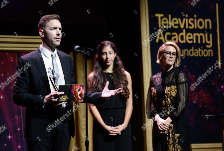 """Henry Hughes, of American Film Institute, accepts the Directing Award for """"Day One"""" at the 36th College Television Awards, presented by the Television Academy Foundation at the Skirball Cultural Center in Los Angeles on . Looking on from far right is Sarah Paulson"""