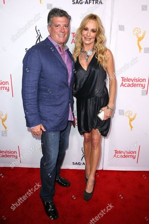 Taylor Armstrong, right, and John Bluher arrive at the 2015 Dynamic and Diverse Emmy Celebration at the Montage Hotel, in Beverly Hills, Calif