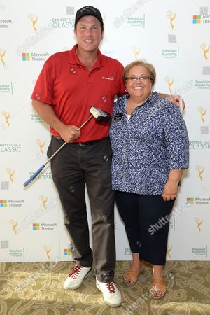 Adam Baldwin, left, and Television Academy Foundation Executive Director Norma Provencio Pichardo are seen at the 16th Emmys Golf Classic presented by the Television Academy Foundation at the Wilshire Country Club on in Los Angeles