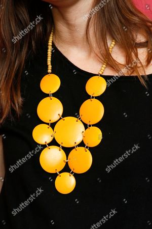 """A necklace worn by author Eleanor Henderson, who wrote the book the film is based, is seen as she poses at the premiere of """"Ten Thousand Saints"""" during the 2015 Sundance Film Festival, in Park City, Utah"""
