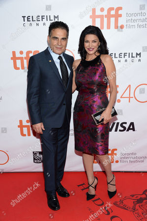 "Shohreh Aghdashloo and Alon Aboutboul attend a premiere for ""Septembers of Shiraz"" on day 6 of the Toronto International Film Festival at Roy Thomson Hall, in Toronto"