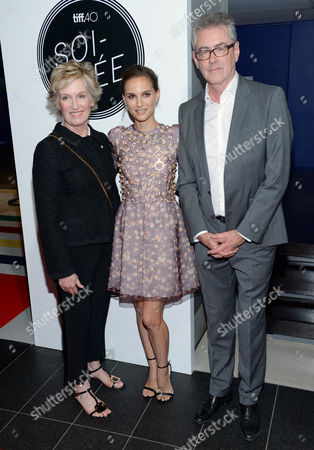 Lisa de Wilde, chair of the board of directors, TIFF, from left, Natalie Portman and Piers Handling, director and CEO of TIFF, attend the TIFF Soiree charity event during the Toronto International Film Festival, in Toronto