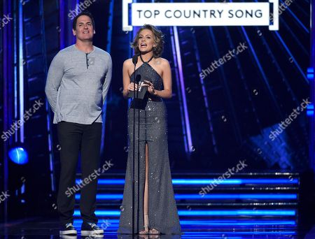 Mark Cuban, left, and Betty Cantrell present the award for top country song at the Billboard Music Awards at the T-Mobile Arena, in Las Vegas