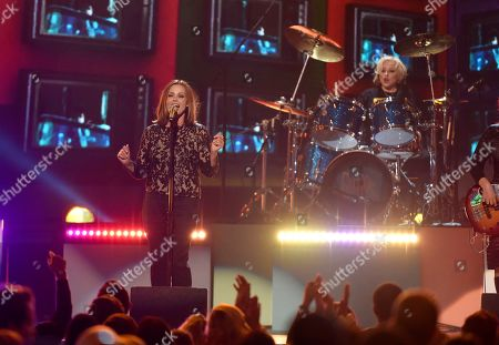 Belinda Carlisle, left, and Gina Schock, of The Go Go's, perform 'We Got The Beat'? at the Billboard Music Awards at the T-Mobile Arena, in Las Vegas