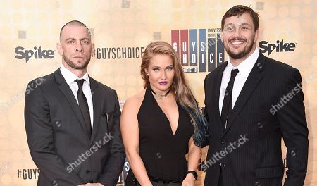 Stock Photo of Joe Schilling, from left, Anastasia Yankova, and Matt Mitrione arrive at the Guys Choice Awards at Sony Pictures Studios, in Culver City, Calif