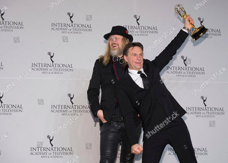 Stock Image of Christer Akerlund, left, and Anders Lundin winners for Non-Scripted Entertainment appear in the press room at the 44th International Emmy Awards at the New York Hilton, in New York