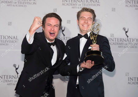 Stock Photo of Matthias Bittner, left, and Paul Zischler winners of the Documentary award appear in the press room for the 44th International Emmy Awards at the New York Hilton, in New York
