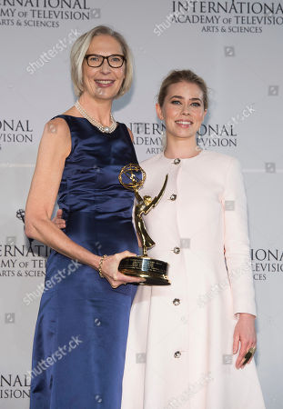 Maria Rorbye Ronn, left, winner of the Directorate Award and presenter Birgitte Hjort Sorensen appear in the press room for the 44th International Emmy Awards at the New York Hilton, in New York