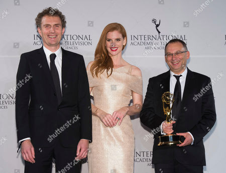 Derek Wax, left, Sarah Rafferty and Euros Lyn appear in the press room at the 44th International Emmy Awards at the New York Hilton, in New York