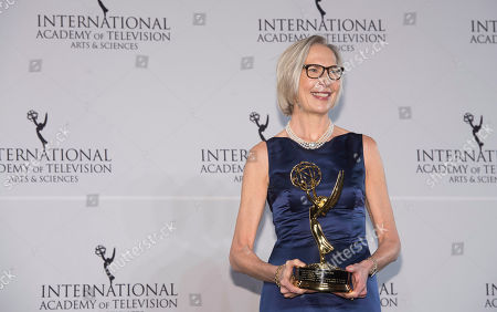 Stock Image of Maria Rorbye Ronn winner of the Directorate Award appears in the press room for the 44th International Emmy Awards at the New York Hilton, in New York