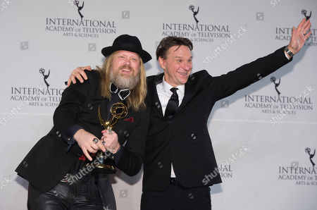 Christer Akerlund, left, and Anders Lundin winners for Non-Scripted Entertainment appear in the press room at the 44th International Emmy Awards at the New York Hilton, in New York