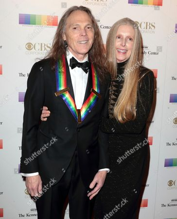 2016 Kennedy Center Honoree Timothy B. Schmit, left, of the band The Eagles with his wife Jean Schmit attend the Kennedy Center Honors gala at the Kennedy Center, in Washington