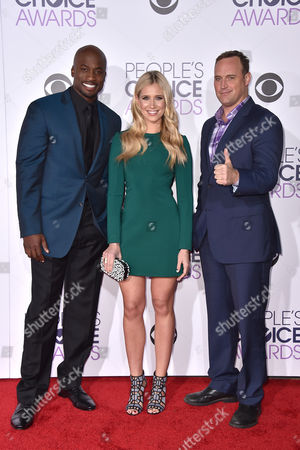 Stock Photo of Akbar Gbaja-Biamila, and from left, Jenn Brown, and Matt Iseman arrive at the People's Choice Awards at the Microsoft Theater, in Los Angeles