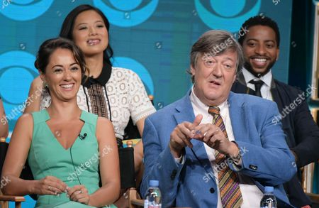 """Christine Ko, from back row left, Shaun Brown, and from front row left, Susan Fielding and Stephen Fry participate in """"The Great Indoors"""" panel during the CBS Television Critics Association summer press tour, in Beverly Hills, Calif"""