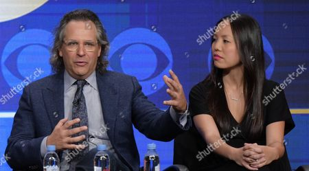 """Executive producers Jason Katims, left, and Michelle Lee participate in the """"Pure Genius"""" panel during the CBS Television Critics Association summer press tour, in Beverly Hills, Calif"""
