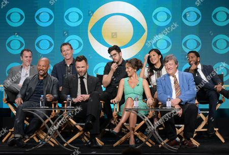 """Executive producers Chris Harris, from back row left, and Mike Gibbons, actors Christopher Mintz-Plasse, Christine Ko, Shaun Brown, and from front row left, Chris Williams, Joel McHale, Susan Fielding and Stephen Fry participate in """"The Great Indoors"""" panel during the CBS Television Critics Association summer press tour, in Beverly Hills, Calif"""