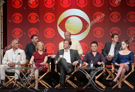 """Executive producers Mark Goffman, from back row left, Phil McGraw and Paul Attanasio, and from front row left, Christopher Jackson, Geneva Carr, Michael Weatherly, Freddy Rodriguez and Annabelle Attanasio participate in the """"Bull"""" panel during the CBS Television Critics Association summer press tour, in Beverly Hills, Calif"""