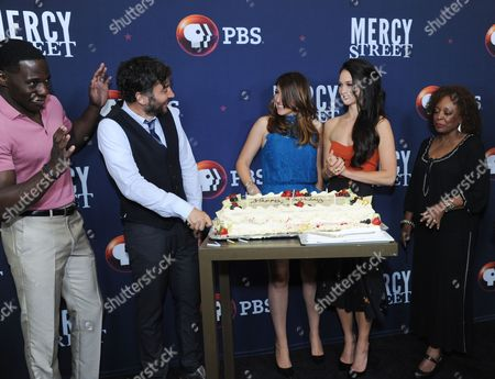 "Josh Radnor, second left left, celebrates his birthday with cast-mates McKinley Belcher III, Tara Summers, Hannah James and L. Scott Caldwell during the ""Mercy Street"" season two portion of the PBS Television Critics Association summer press tour, in Beverly Hills, Calif"