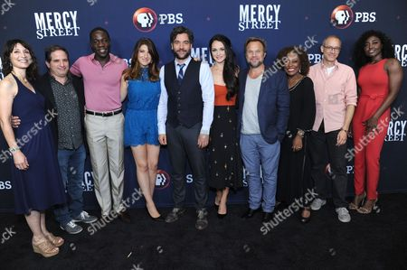"Executive Producer Lisa Wolfinger, from left, executive producer David Zabel, McKinley Belcher III, Tara Summers, Josh Radnor, Hannah James, Norbert Leo Butz, L. Scott Caldwell, producer David Zucker and Patina Miller pose for photos during the ""Mercy Street"" season two portion of the PBS Television Critics Association summer press tour, in Beverly Hills, Calif"