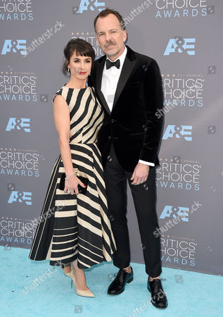 Constance Zimmer, left, and Russ Lamoureux arrive at the 21st annual Critics' Choice Awards at the Barker Hangar, in Santa Monica, Calif