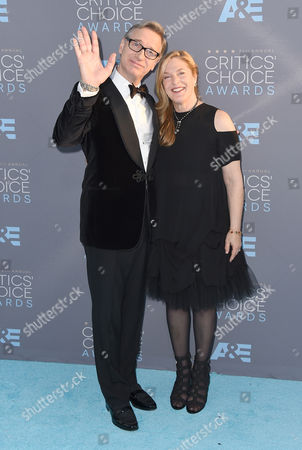 Paul Feig, left, and Laurie Karon arrive at the 21st annual Critics' Choice Awards at the Barker Hangar, in Santa Monica, Calif