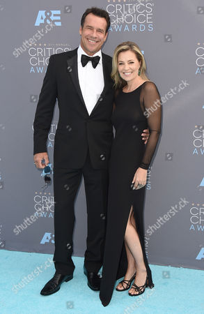 David James Elliott, left, and Nanci Chambers arrive at the 21st annual Critics' Choice Awards at the Barker Hangar, in Santa Monica, Calif