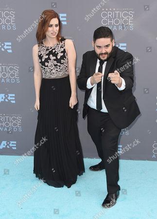 Stock Image of Bree Essrig, left, and Steve Zaragoza arrive at the 21st annual Critics' Choice Awards at the Barker Hangar, in Santa Monica, Calif