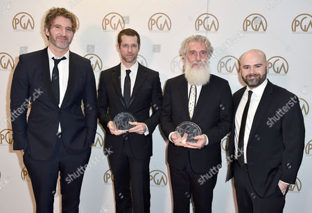 David Benioff, from left, D.B. Weiss, Chris Newman, and Bryan Cogman pose with the Norman Felton award for outstanding producer of episodic television drama for Game of Thrones at the 27th annual Producers Guild Awards at the Hyatt Regency Century Plaza, in Los Angeles