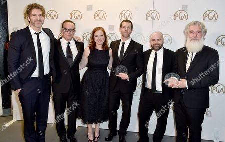 Clark Gregg, second from left, and PGA chair Jennifer Todd, third from left, pose with David Benioff, from left, D.B. Weiss, Bryan Cogman, and Chris Newman, winners of the Norman Felton award for outstanding producer of episodic television drama for Game of Thrones at the 27th annual Producers Guild Awards at the Hyatt Regency Century Plaza, in Los Angeles