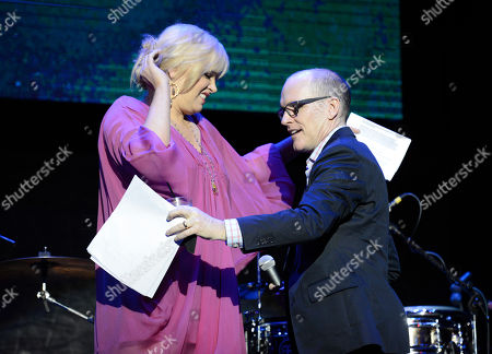 Melissa Peterman, left, and Greg Fitzsimmons speak on stage at the 2nd Annual California Fire Foundation Gala at Avalon Hollywood, in Hollywood, Calif